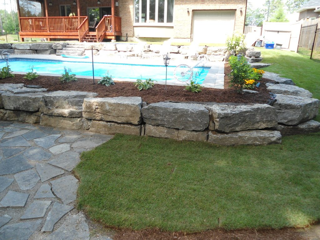 Pool stone retaining wall husky property for Pool design retaining wall